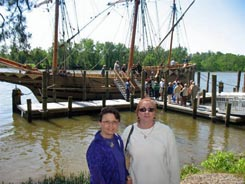 HCHS President Sarah Pace and Recording Secretary Diane Brownie pose before the Godspeed docked at the Citie of Henricus.
