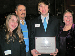 Trevor Dickerson with his APVA Young Preservationist of the Year Award surrounded by his proud family.