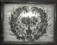 Elaborate framed Victorian wreath of woven hair (approximately 30