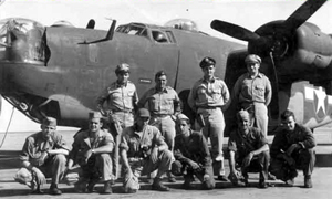Sheppard (kneeling, third from the left) poses with his regular flight crew.