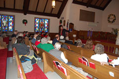 Ben Gregory discusses the history of Calvary United Methodist Church with HCHS members at their December 2010 meeting.
