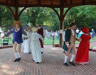 Colonial Dance Company performing in gazebo.