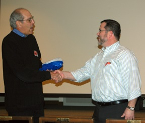 Bo Williams of Total Printing accepts award of contribution to HCHS from joey Boehling.