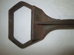 Smaller 4-inch wide section of iron item.