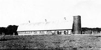 Curles Neck barns, circa 1930, in Varina District, Henrico County, Virginia.