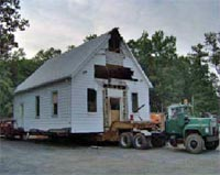 Springfield Baptist Church, dismantled building being moved on a flatbed truck from Henrico County, Virginia to Goochland County, Virginia.